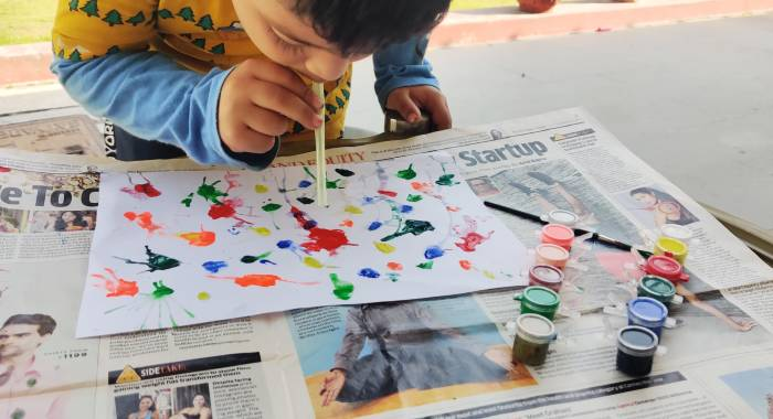 Blow painting with straw Holi art and craft