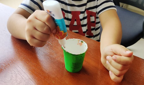 Paste glue over the green cup